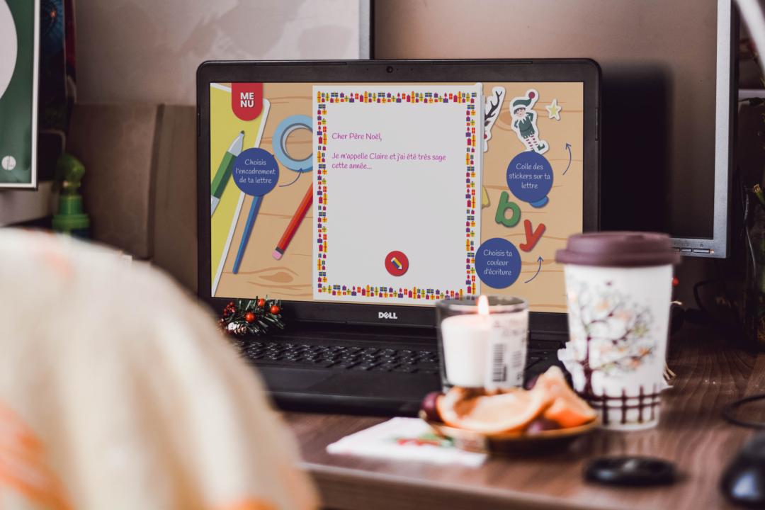 Ecran d'ordinateur sur un bureau avec le site du Père Noël pour lui écrire une lettre numérique